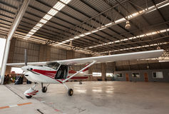 Small airplane with propeller in front parking in terminal. Stock Image