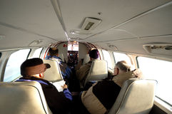 Small Airplane Ride. Interior of a small airplane with four passengers, flying north Royalty Free Stock Image