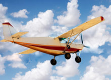 Small airplane in the sky Stock Photos