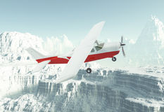 Small airplane in snow mountains Royalty Free Stock Photography