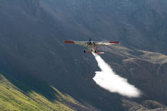 Small Airplane Spraying Mountain Lakes Stock Images