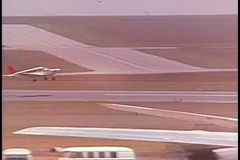 Small airplane taking off from air field stock footage