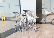 Small Airport trolley caariage many empty isolated royalty free stock photography