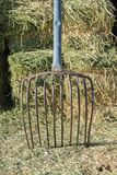 Small alfalfa hay bales stacked with pitch fork on farm. Alfalfa hay bales stacked pitch fork farm horses livestock feed country agricultural agriculture farming royalty free stock image