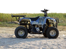 Small All Terrain Vehicle. On a beach Stock Images