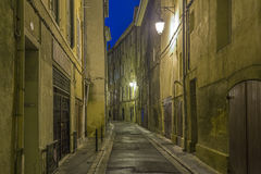 Small alley by night in Aix Stock Photo