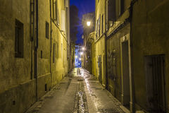 Small alley by night in Aix Stock Photography