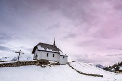 Small church in alpine village Stock Images