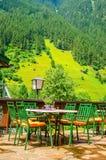 Small Alpine restaurant on terrace, Austria. Small Alpine restaurant on the terrace on the background of the Alps, Austria Royalty Free Stock Photos