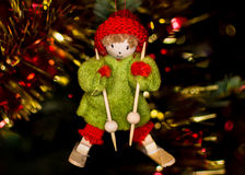 Small Alsatian character in the tree of Noel, bokeh in backgroun Royalty Free Stock Photo