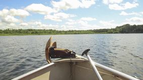 A wide angle point of view boating timelapse from the front of a small aluminum fishing craft on a perfect summer day. A small aluminum watercraft boats around a stock video footage