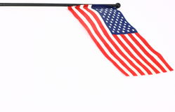 Small American Flag. A small American flag with a black plastic pole photographed on a white background Royalty Free Stock Photos