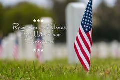 Small American flag at National cemetary - Memorial Day display -. Small American flags and headstones at National cemetary- Memorial Day display - with copy Royalty Free Stock Photo