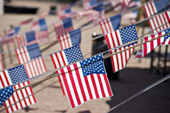 Small American flags. A large number of American flags hanging horizontally royalty free stock images