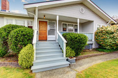 Small American home with light exterior and white trim. Stock Photography