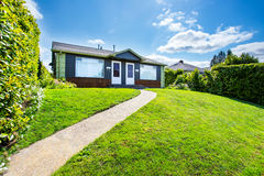 Small American two family house with concrete walkway Stock Image