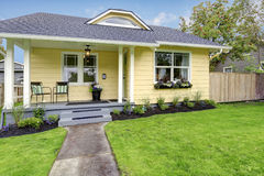 Small American yellow house exterior Stock Image