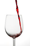 Small amount of red wine being poured Royalty Free Stock Photo
