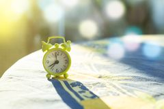 Small analogue clock in the evening light.  Royalty Free Stock Images