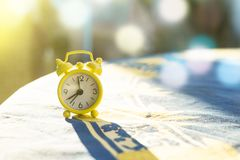 Small analogue clock in the evening light.  Royalty Free Stock Image
