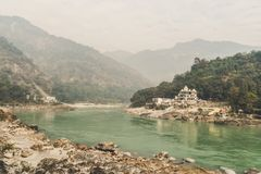 A small ancient Ashram on the Bank of the Ganges river in the Himalayas mountains. Sacred indian place - Rishikesh. stock photos