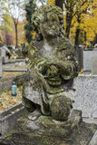 Small Angel. Cherubin  on the Tomb in Rakowicki cemetary in Krakow. Autumn time Stock Images