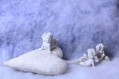 Small angel figurines Stock Photos