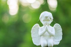 Small angel statue in cemetery Royalty Free Stock Image