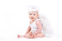 Small angel with the wings isolated on the white. Royalty Free Stock Photos