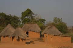 Small Angolan village with adobe housing and straw roofs stock image