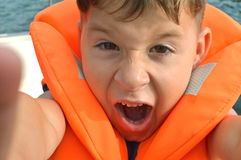 Small angry boy at sea Stock Images