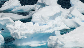 Small Antarctic Icebergs. A group of broken and eroded Icebergs creating a montage of colors and shapes - Antarctic Stock Image