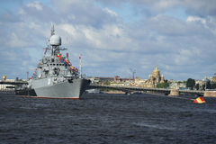 Small anti-submarine ship Urengoy on the background of the embankment of Lieutenant Schmidt. Navy day in St. Petersbur Stock Photography
