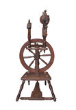 Small antique spinning wheel isolated. Stock Photo