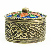 Small antique Tunisian jewel casket. A small round metal jewel casket with an antique look. The casket is seen from the side Royalty Free Stock Images