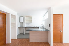 Small Apartment. Kitchen of a small one bedroom empty apartment stock photos