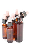 Small apothecary bottles with an eyedropper Stock Images