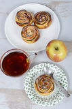 Small apple cakes with a cup of tea and apple Royalty Free Stock Image