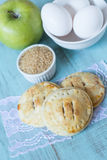 Small Apple Hand Pies With Raw Sugar and Eggs Vertical Royalty Free Stock Image