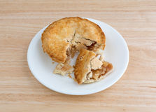 Small apple pie on plate upon a table top Stock Photos