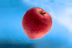 Small apple in see trough water Royalty Free Stock Photo