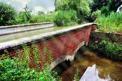 Small aqueduct. Small rural aqueduct with two flows Royalty Free Stock Photography