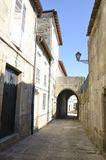 Small arch in picturesque alley. Of Tui, a town of the province of Pontevedra, in Galicia, Spain Stock Photo