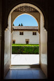 Small arched entry into interior courtyard garden Stock Photos