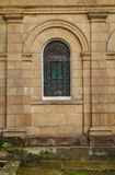 Small arched window of an early nineteenth century mansion Royalty Free Stock Images