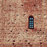 Small arched window in a red brick Royalty Free Stock Image