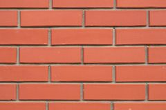 Loft background new brick wall. A small fragment of a new beautiful brick wall close up. royalty free stock images
