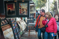 Small art and souvenir shop with buyers in Paris Royalty Free Stock Images