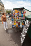 Small art and souvenir shop with walking tourists in Paris Stock Images