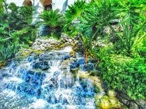 Small Artifical waterfall in Riverwalk/San Antonio royalty free stock images